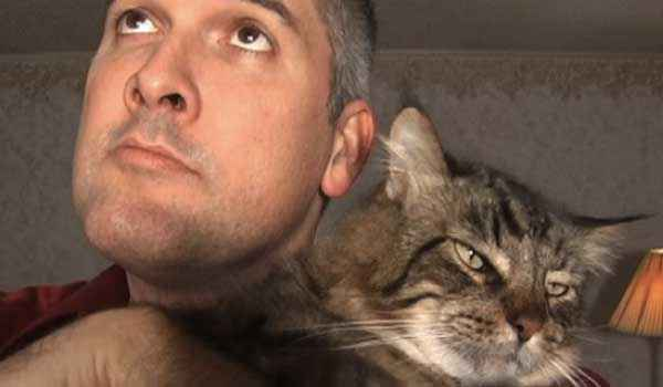 Paul Klusman and his cat, Zoey.